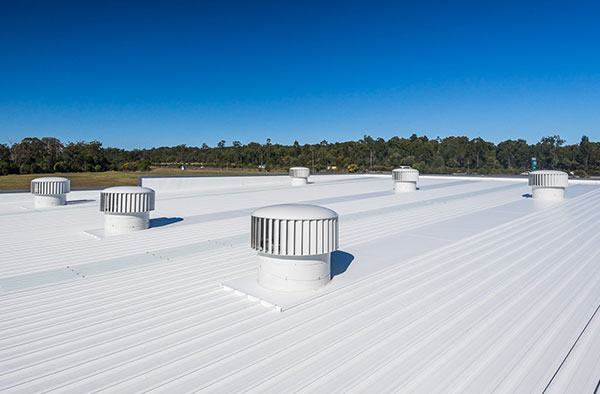 Matching wind-powered Hurricane ventilators on roof